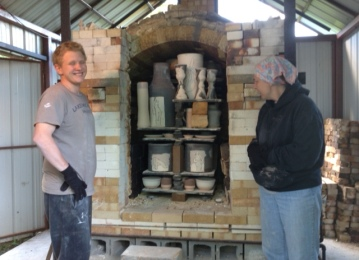 Kim L'Heureux and Kieran Elder having just stacked the salt kiln.