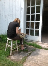 Rebecca Schoonmaker working on her raku tile.
