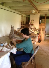 Christine Toro working on sculpture at raku workshop